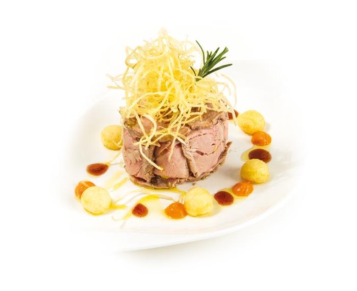 Patata di Bologna DOP - ricette - Patata di Bologna D.O.P. nel tortino di filetto di maiale e fondo di cottura al peperone dolce.