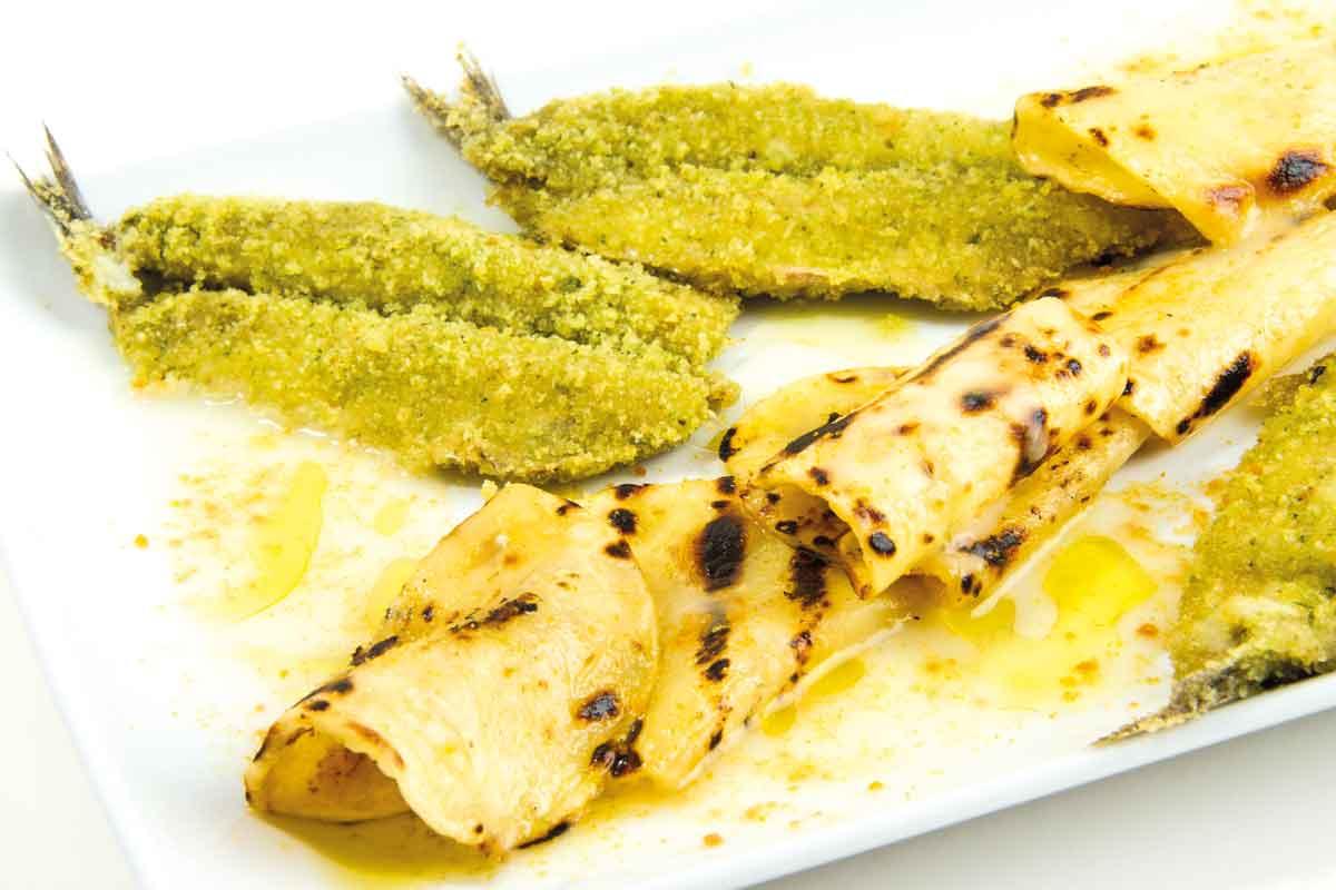 Patata di Bologna D.O.P. alla griglia con alici gratinate, condite con patata e bottarga di muggine.